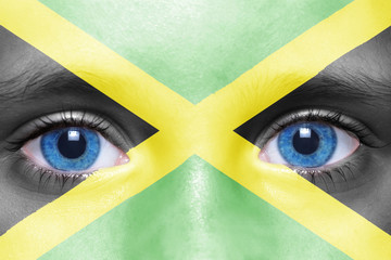 human's face with jamaican flag