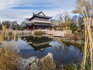 lake in front of a japanese style house