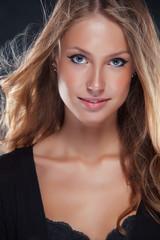 Vivacious beautiful blonde woman in lingerie