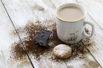 Cookie, cocoa and cup of coffee on wooden table