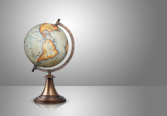 old style globe on gray background