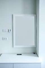 White wooden vanity table in white room