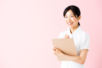 portrait of asian nurse isolated on pink background