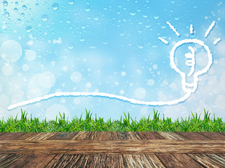 Empty wooden table and grass with Cloud bubble for message on water drops bokeh background. Product display template..
