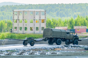 Nizhniy Tagil, Russia - July 12. 2008: army truck with cannon moving after water ford. Russia Arms Expo