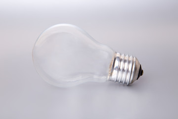 The lightbulb on a silver background