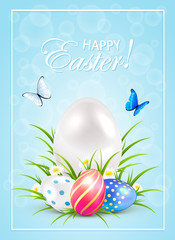 Easter eggs on grass and butterflies on blue background