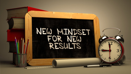 Handwritten New Mindset for New Results on a Chalkboard. Composition with Chalkboard and Stack of Books, Alarm Clock and Rolls of Paper on Blurred Background. Toned Image. 3D Render.