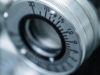 Photograph of a dial on a phoropter in an eye doctor's office. The dial is seen in close up with shallow depth of focus.
