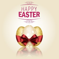 Three Golden Easter eggs with ribbons on brown background