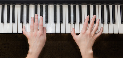Woman hands playing piano music.