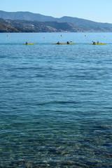 People rowing yellow canoes