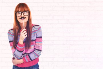 Composite image of smiling hipster woman with a mustache