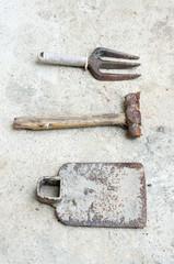 used old tools on cement background