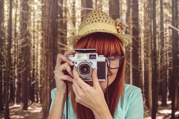 Portrait of a smiling hipster woman holding retro camera Wall mural