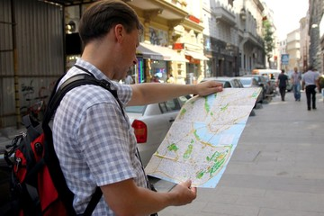 White man with map travelling