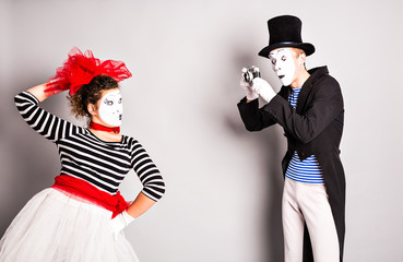 Funny couple of mimes taking a  photo,  April Fools Day
