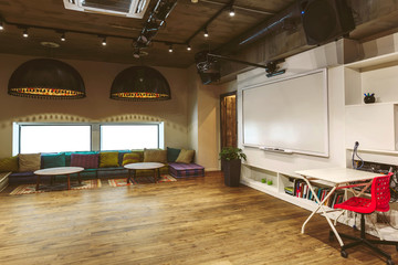 Loft cafe interior, meeting room with desk, comfortable seat place