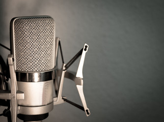 Silver microphone on blue gray background