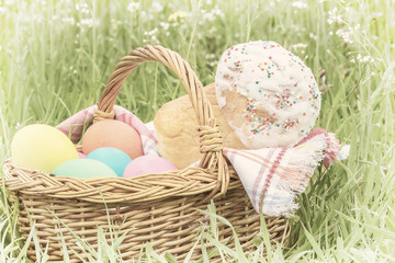 Wicker basket with eggs and Easter cake