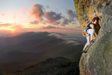 Young female rock climber climbing challenging route on rocky wall against scenic sunset background. Summer time.