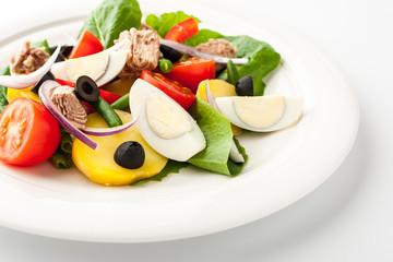 Nicoise salad on the white ceramic plate