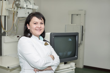 Brunette female doctor working with an x-ray machine