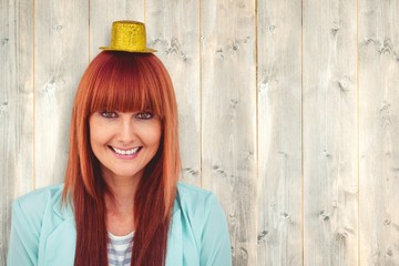 Composite image of smiling hipster woman wearing hat party