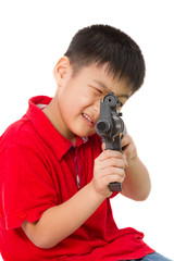 Asian Little Boy Playing Plastic Toy AK47