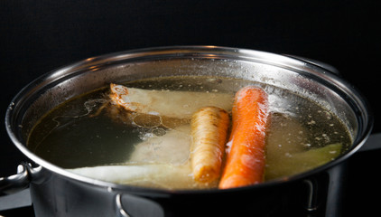 Cooking base of chicken soup, bouillon in pot