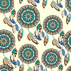 Seamless pattern with hand drawn dreamcatchers. Colorful vector illustrations on light yellow background. Boho style design elements. Tribal style design