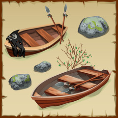 Two ancient pirate boats on land