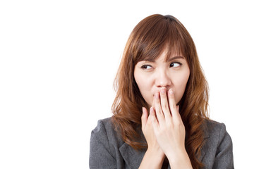 business woman covering her mouth, looking up