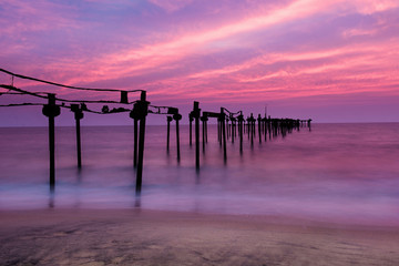 Aluminium Prints Candy pink Long exposure sea pier with beautiful sunset