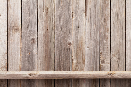 Wood shelf in front of wooden wall