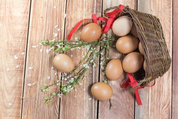 Easter - Spilled Hen Eggs in a Wicker Basket with a Ribbon and S