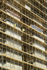 Large scaffolding with workers on a construction site