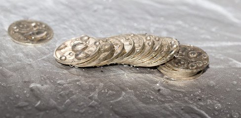 coins in a spray of water