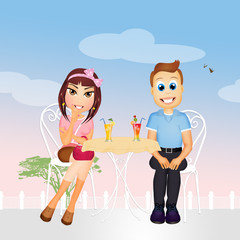 Man and woman drinking cocktail