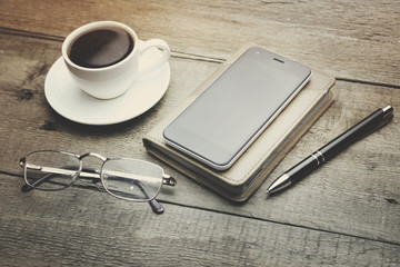 coffee, phone, notebook, pen and glass