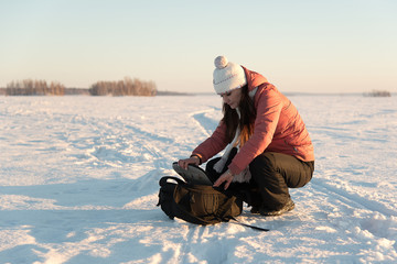 Portrait of beautiful woman with camera on winter snow day