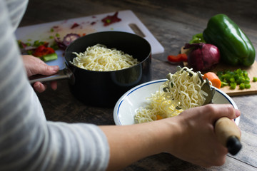 Woman Preparing Asian Noodles