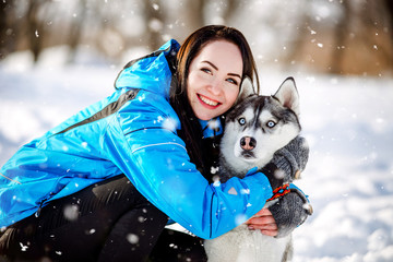 girl with a dog in winter Husky