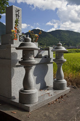 Family memorials and rice fields in Yufuin, Oita, Japan