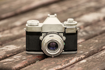 Old SLR camera on a wooden base