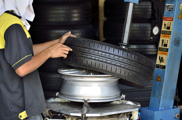 Change the tires or wheel with high performance machine in the automobile repair shops.