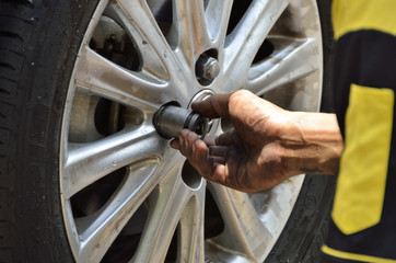 Change the tires or wheel with high performance machine in the automobile repair shops (Selective focus).
