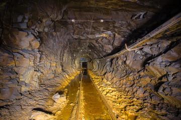 Underground abandoned gold mine ore tuneel with rails Berezovsky mine Ural