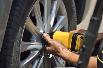 Change the tires or wheel with auto screw in automobile repair shops (Selective focus).