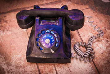 Retro black old vintage telephone on table with brick grunge bac